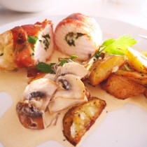 Parma wrapped chicken with cheese filling, sliced potatoes and mushroom sauce