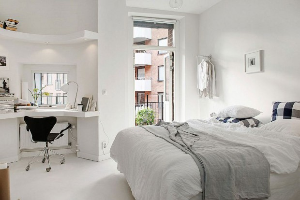 Natural-ventilation-and-corner-workspace-add-to-the-charm-of-the-loft-bedroom