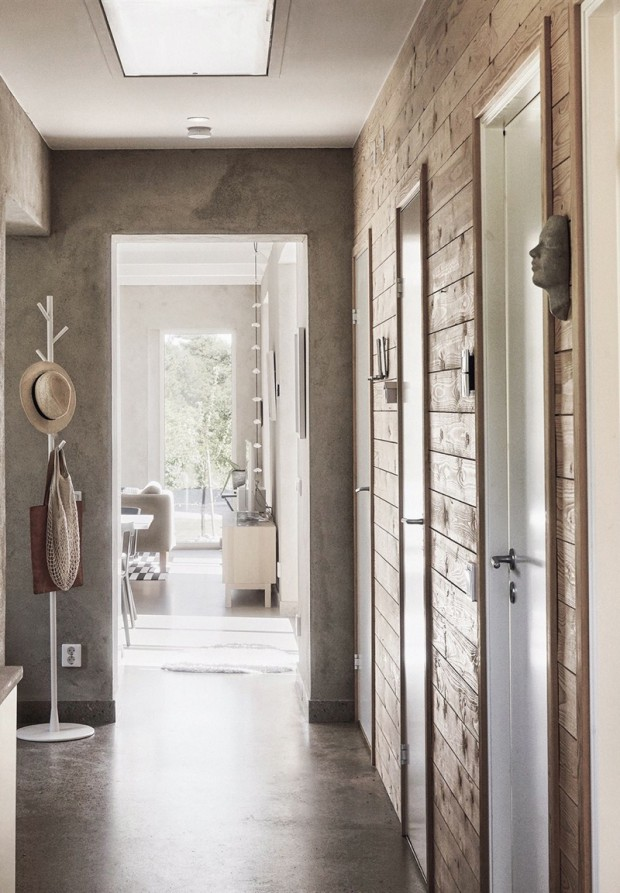 hallway.-glossy-concrete-floor-raw-wooden-wall